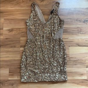 bebe addiction gold sequin dress.
